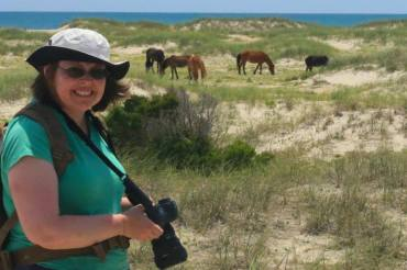 Here I am at one of my favorite places - Shackleford Banks, NC. My husband, Mike, and I love to find the wild horses and take pictures of them.